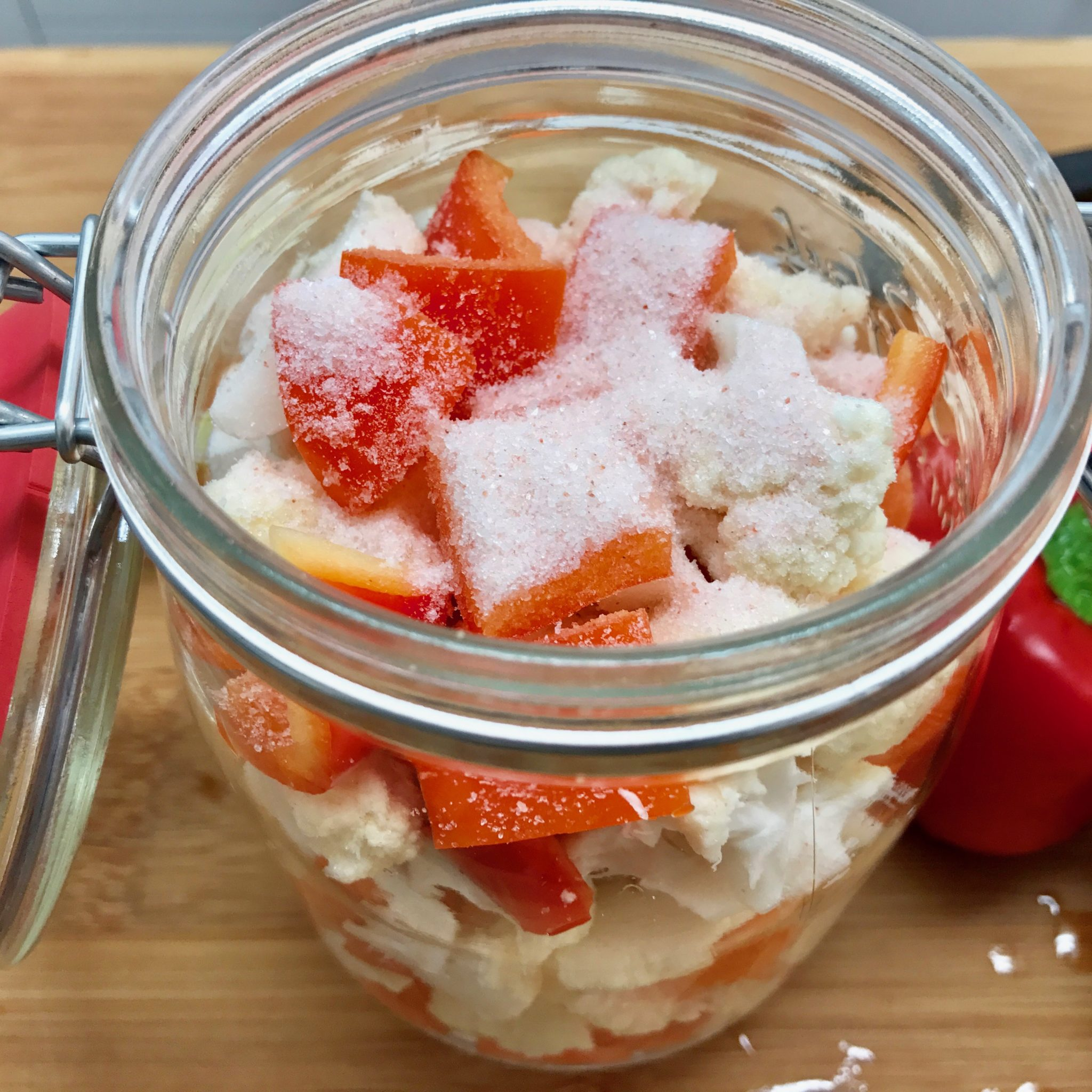 Put cut vegetables in the jar and add salt