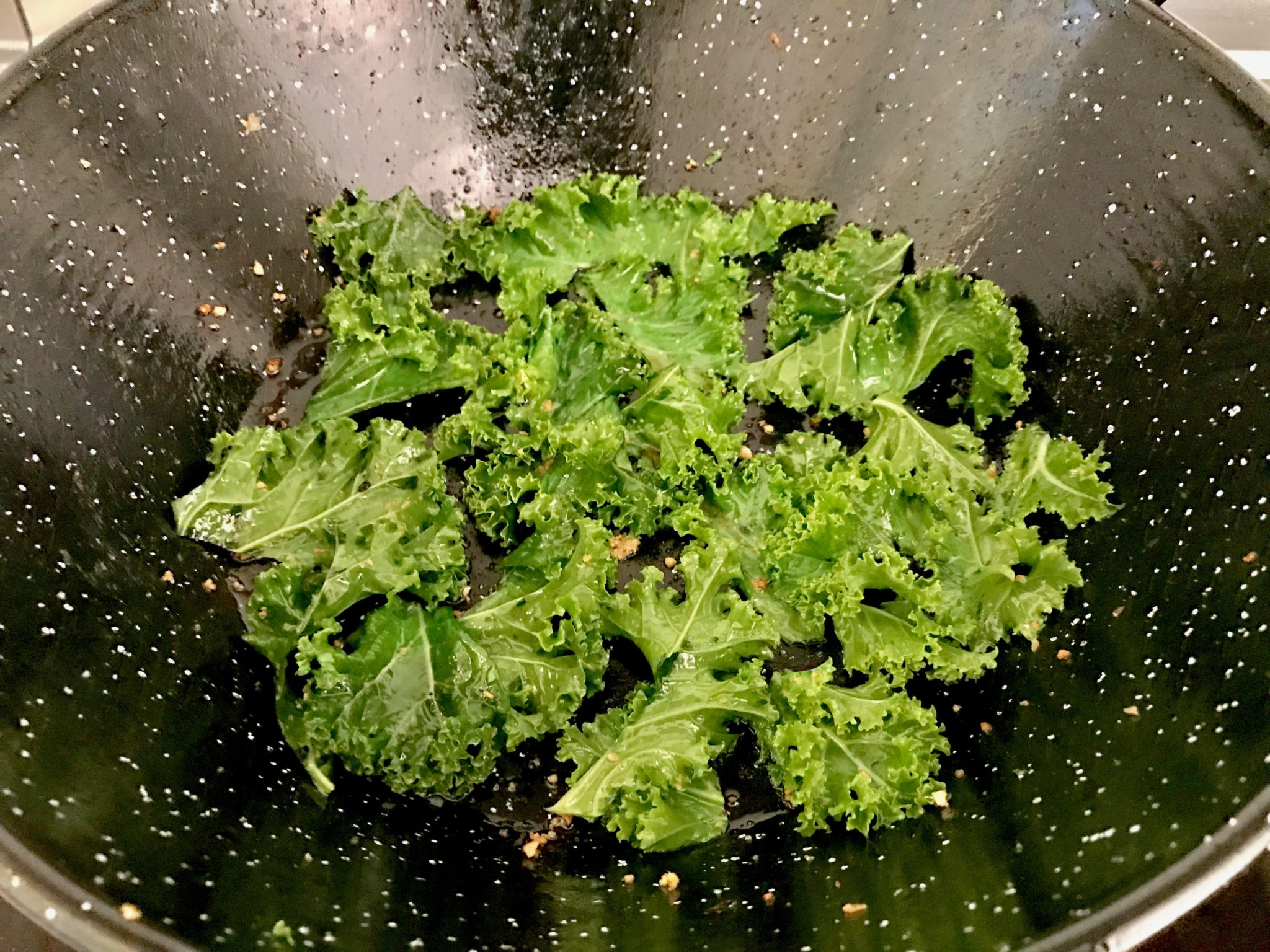 kale mix with garlic, coconut oil and salt