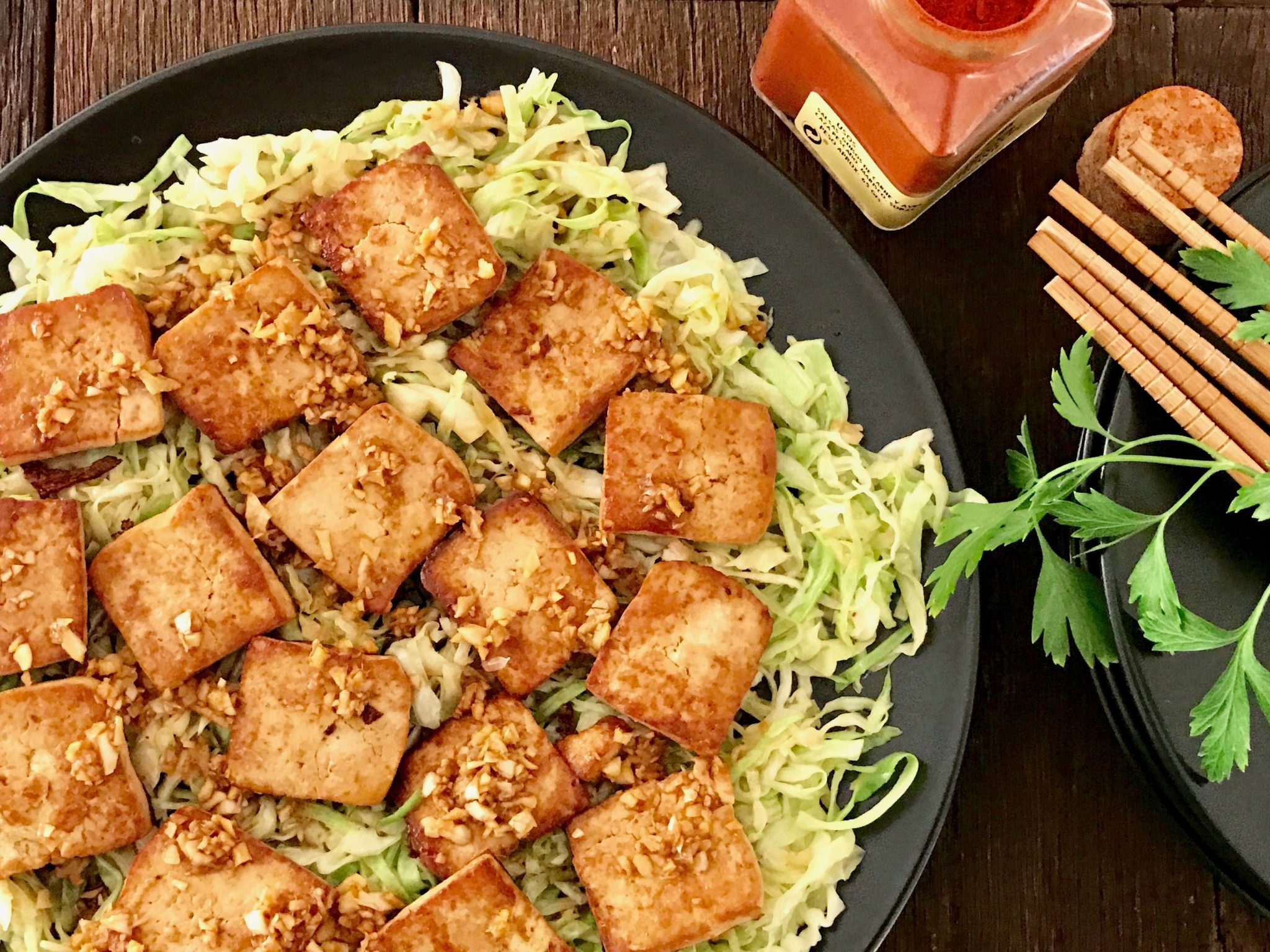 pour the sauce over the tofu and cabbage